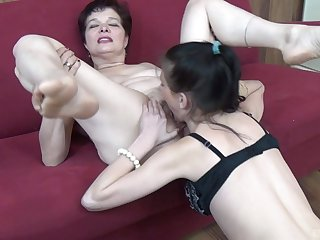 Dirty granny enjoys object the brush pussy licked wits a younger chick